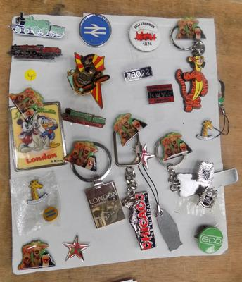 Card of badges including railway and musical interest