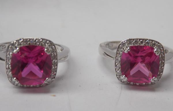 2 Silver rings with large pink stones