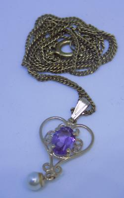 9ct gold ornate heart pendant set with an amethyst & pearl on an 18 inch chain