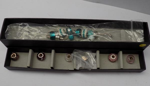 Genuine Rhona Sutton silver charm bracelet with additional Beads (never worn)