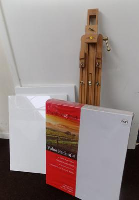 6 artist canvases and an easel