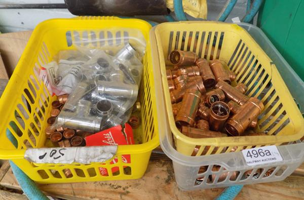 Three baskets of copper fittings