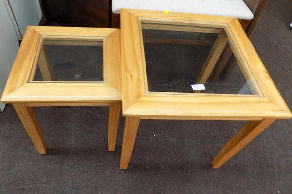 Two pine, glass topped tables