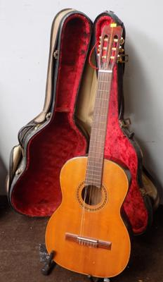 Vintage acoustic guitar with hard travel case