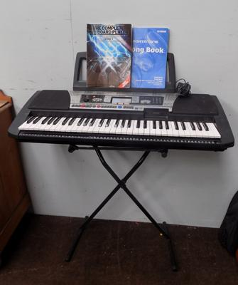 Yamaha keyboard with stand + books in W/O