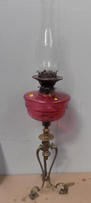 Cranberry glass oil lamp