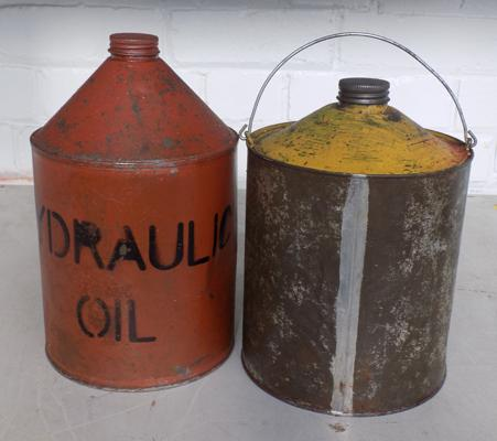 Two cans of oil, round tins, clean oil