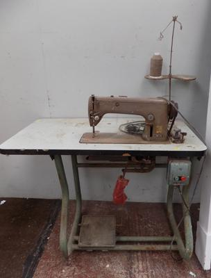 Industrial sewing machine on stand in W/O