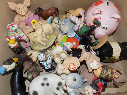 Collection of pigs and other ornaments