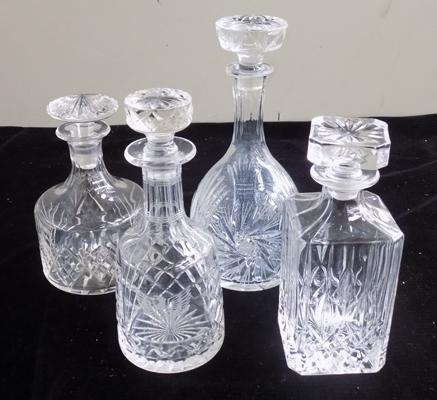 Four cut glass decanters