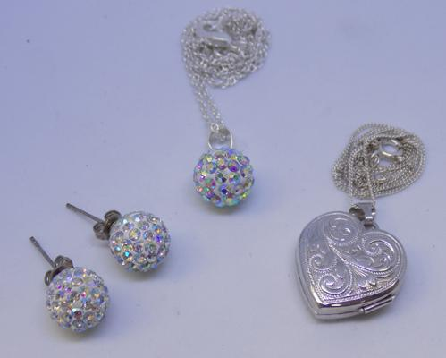 Silver locket and chain with matching silver necklace and earrings