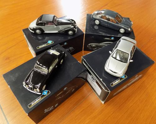 Four collector's cars in presentation tins