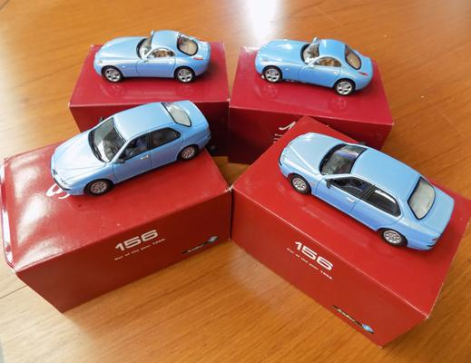 Four collectors cars in presentation tins