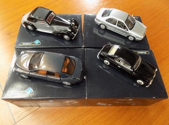 Four collector's cars in tins