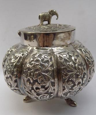 Ornate white metal Indian themed container
