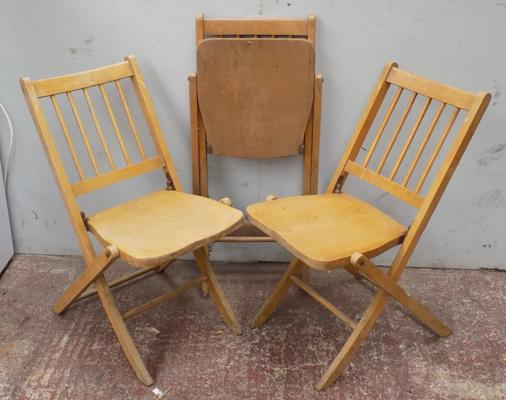 Trio of vintage wooden folding chairs