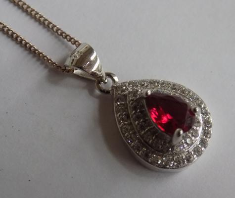Red stone silver pendant on silver chain