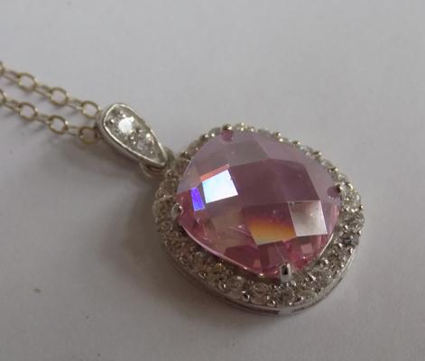 Large pink stone silver pendant on silver chain