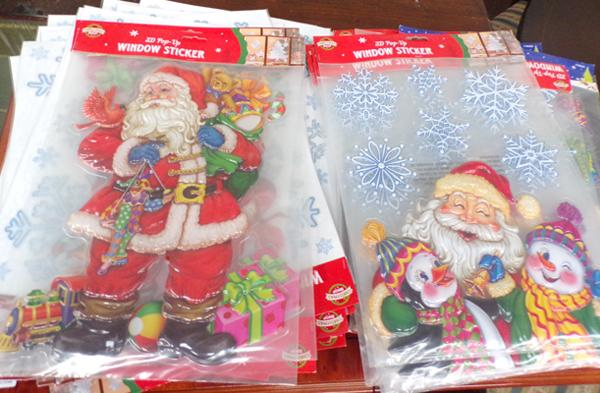 32 packs of Christmas window stickers