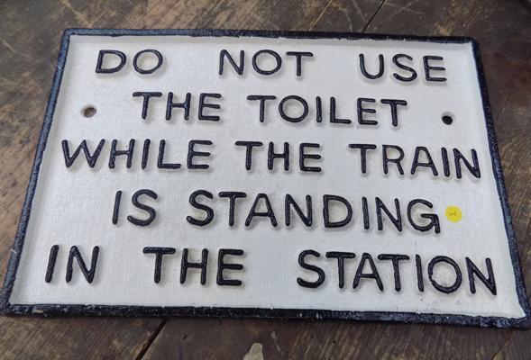 Cast iron toilet sign approx 11.5 inches x 7.5 inches