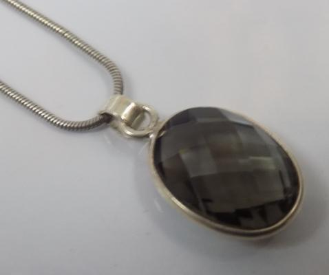 Unusual large stone silver pendant on silver snake style chain