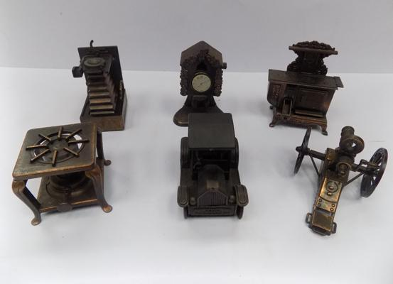 Six bronzed novelty pencil sharpeners