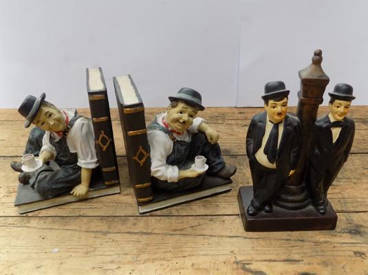 Pair of Laurel and Hardy book ends and one other