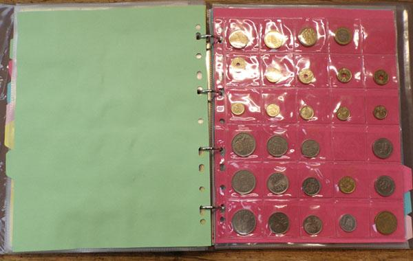 Large album of mixed British & World coins - 4 x £1 notes, display wallets of Malta & Egyptian coins, beige album