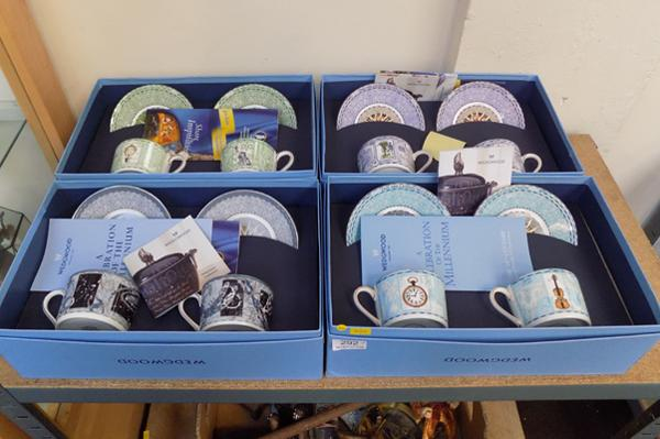 Four Wedgwood Millennium Collection boxed teacups & saucers, 18th, 19th, 20th, 21st century