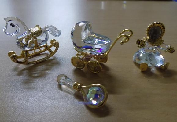 Collection of Swarovski crystals - doll, rocking chair, baby's rattle & pram