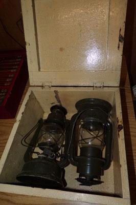 Two paraffin lamps in wooden box