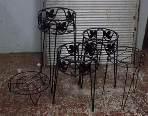 Three metal floral plant stands and two others
