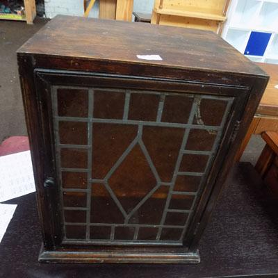 Stained glass fronted shelved unit