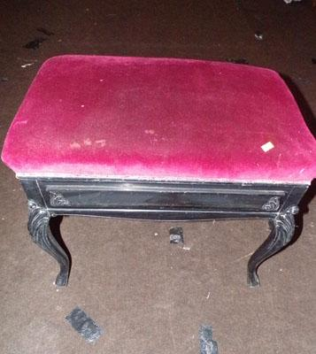Double piano stool with music stand and sheet music