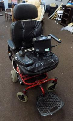 Electric wheelchair with charger in W/O
