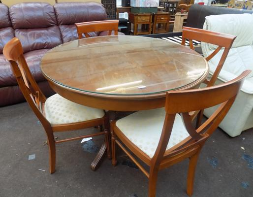 Glass top round dining table and four chairs
