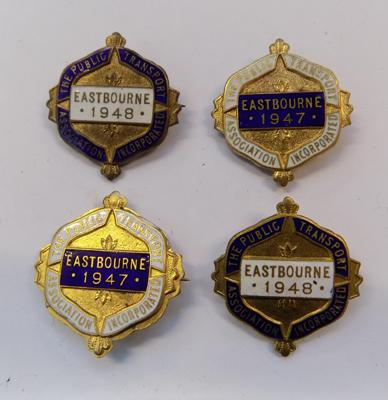 Four vintage enameled Public Transport Association badges