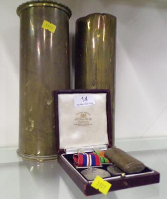 Two brass shell casings 1910 + 1917 & Home Defence medals 1945