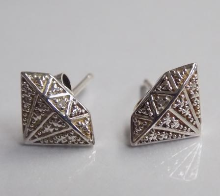 Pair of diamond earrings, shaped as diamonds
