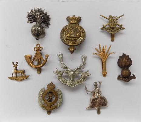 A collection of genuine WWI & WWII era British military cap badges