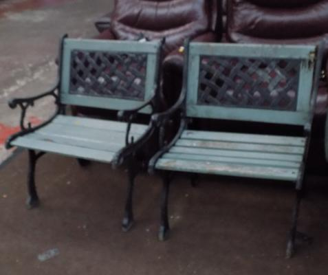 Two cast iron garden chairs