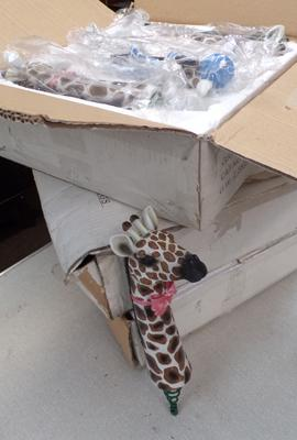 Three boxes of garden giraffe ornaments on springs