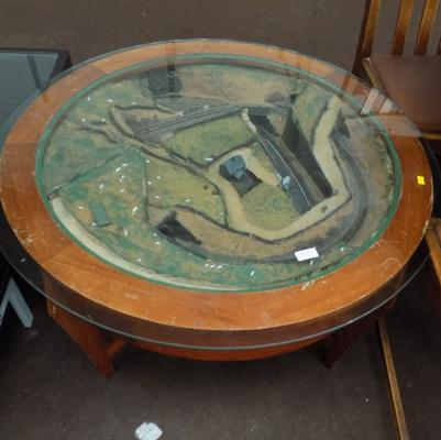 Glass topped oval side table with train track feature