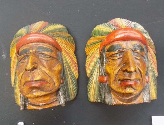 Pair of 9 inch carved Indian heads