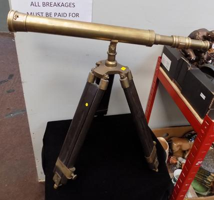 Brass telescope on adjustable tripod stand