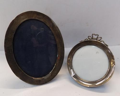Two silver photo frames, some damage