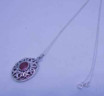 Celtic silver and ruby pendant on silver chain