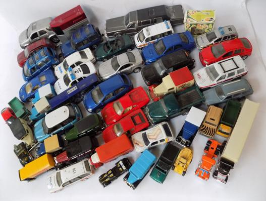 Box of assorted loose diecast cars