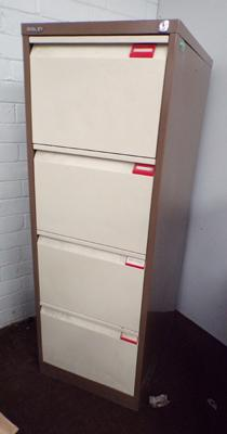 Four drawer metal filing cabinet with inserts