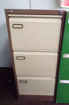 Three drawer metal filing cabinet with inserts